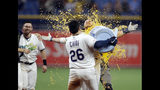 Tampa Bay Rays' Ji-Man Choi (26) douses Michael Brosseau after Brosseau's walkoff RBI single off Detroit Tigers relief pitcher Matt Hall scored Eric Sogard during the 13th inning of a baseball game Saturday, Aug. 17, 2019, in St. Petersburg, Fla. (AP Photo/Chris O'Meara)