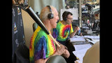 Bill Walton does commentary on NBC Sports Chicago for the Chicago White Sox's baseball game against the Los Angeles Angels on Friday, Aug. 16, 2019, in Anaheim, Calif. Walton was calling the game on an invitation from the White Sox and announcer Jason Benetti, right. (AP Photo/Joe Reedy)