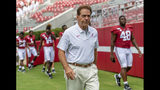 FILE - In this Aug. 3, 2019, file photo, Alabama head coach Nick Saban leaves the field after a team photo prior to Alabama's fall camp fan-day college football scrimmage, in Tuscaloosa, Ala. Alabama is hardly immune to change, with an assemblage of new assistant coaches and the next wave of blue-chip prospects replacing the old ones. Two constants remain: coach Nick Saban and championship expectations. (AP Photo/Vasha Hunt)