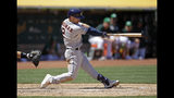 Houston Astros' Alex Bregman swings for a three-run home run off Oakland Athletics' Brett Anderson in the fifth inning of a baseball game Sunday, Aug. 18, 2019, in Oakland, Calif. (AP Photo/Ben Margot)