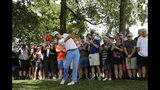 Justin Thomas hits his second shot on the first hole during the final round of the BMW Championship golf tournament at Medinah Country Club, Sunday, Aug. 18, 2019, in Medinah, Ill. (AP Photo/Nam Y. Huh)