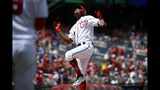 Washington Nationals' Victor Robles celebrates his home run during the first inning of a baseball game against the Milwaukee Brewers, Sunday, Aug. 18, 2019, in Washington. (AP Photo/Nick Wass)