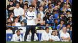 Chelsea's head coach Frank Lampard stands by the bench after Leicester tied the game 1-1 during the English Premier League soccer match between Chelsea and Leicester City at Stamford Bridge stadium in London, Sunday, Aug. 18, 2019. (AP Photo/Frank Augstein)