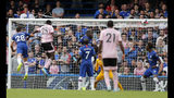 Leicester's Wilfred Ndidi, 2nd left, scores his side's first goal during the English Premier League soccer match between Chelsea and Leicester City at Stamford Bridge stadium in London, Sunday, Aug. 18, 2019. (AP Photo/Frank Augstein)