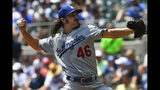 Los Angeles Dodgers' Tony Gosolin pitches against the Atlanta Braves during the first inning of a baseball game Sunday, Aug. 18, 2019, in Atlanta. (AP Photo/John Amis)