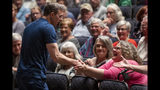 FILE - In this May 28, 2019, file photo, Rep. Justin Amash, D-Mich., greets the crowd before holding a town hall meeting at Grand Rapids Christian High School's DeVos Center for Arts and Worship. Democrats may be the biggest winners from Amash's impeachment stand against President Donald Trump. Amash has left the Republican Party, is running for re-election as an independent and is flirting with a White House bid as a libertarian _ a threat that could wound Trump one more time. (Cory Morse/The Grand Rapids Press via AP)