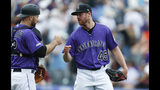 Colorado Rockies catcher Chris Iannetta, left, congratulates relief pitcher Scott Oberg who retired San Francisco Giants pinch hitter Pablo Sandoval for the final out in the ninth inning of a baseball game Sunday, Aug. 4, 2019, in Denver. (AP Photo/David Zalubowski)