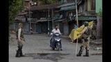 Indian paramilitary soldiers turn back a Kashmiri motorist near a temporary check point during lockdown in Srinagar, Indian controlled Kashmir, Sunday, Aug. 18, 2019. (AP Photo/ Dar Yasin)