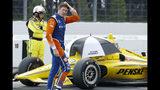 Scott Dixon walks down pit road as inclement weather delays an IndyCar Series auto race at Pocono Raceway, Sunday, Aug. 18, 2019, in Long Pond, Pa. (AP Photo/Matt Slocum)