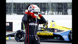 Will Power walks down pit road as inclement weather delays an IndyCar Series auto race at Pocono Raceway, Sunday, Aug. 18, 2019, in Long Pond, Pa. (AP Photo/Matt Slocum)