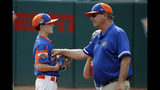 Bowling Green, Ky., pitcher Jameson Napper, left, gets a visit from manager Rick Kelley during the fifth inning of a game against Barrington, R.I., at the Little League World Series baseball tournament in South Williamsport, Pa., Saturday, Aug. 17, 2019. Rhode Island won 6-1. (AP Photo/Gene J. Puskar)