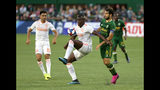 "Atlanta United's Florentin Pogba, center, controls the ball as teammate Gonzalo ""Pity"" Martínez, left, looks on and Portland Timbers' Diego Valeri attempts to maneuver around him during an MLS soccer match host in Portland, Ore., on Sunday, Aug. 18, 2019. (Sean Meagher/The Oregonian via AP)"