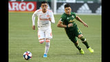 Portland Timbers' Jorge Moreira, right, and Atlanta United's Ezequiel Barco vie for the ball during an MLS soccer match at Providence Park in Portland, Oregon on Sunday, Aug. 18, 2019. (Sean Meagher/The Oregonian via AP)
