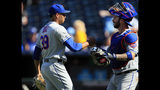 New York Mets relief pitcher Edwin Diaz (39) shakes hands with catcher Tomas Nido (3) following a baseball game against the Kansas City Royals at Kauffman Stadium in Kansas City, Mo., Sunday, Aug. 18, 2019. The Mets defeated the Royals 11-5. (AP Photo/Orlin Wagner)