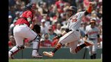 Baltimore Orioles' Renato Nunez (39) scores on a double by Hanser Alberto as Boston Red Sox's Sandy Leon, left, waits for the throw during the third inning of a baseball game in Boston, Sunday, Aug. 18, 2019. (AP Photo/Michael Dwyer)