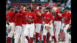 Boston Red Sox's Mookie Betts, foreground left, and Andrew Benintendi, center, celebrate with teammates after defeating the Baltimore Orioles in a baseball game in Boston, Sunday, Aug. 18, 2019. (AP Photo/Michael Dwyer)