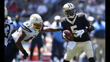 New Orleans Saints quarterback Teddy Bridgewater (5) is pressured by Los Angeles Chargers linebacker Uchenna Nwosu (42) during the first half of a preseason NFL football game Sunday, Aug. 18, 2019, in Carson, Calif. (AP Photo/Kelvin Kuo)