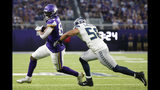Minnesota Vikings tight end Irv Smith, left, runs from Seattle Seahawks outside linebacker Austin Calitro, right, after making a reception during the first half of an NFL preseason football game, Sunday, Aug. 18, 2019, in Minneapolis. (AP Photo/Bruce Kluckhohn)