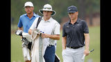 John Augenstein walks up to the green with his caddy during the final round against Andy Ogletree, at the USGA Amateur Golf Championship at the Pinehurst Country Club , in Pinehurst, N.C, Sunday, Aug. 18, 2019, (AP Photo/Karl B DeBlaker)