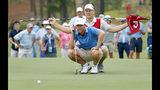 Andy Ogletree eyes his putt during the final round against John Augenstein at the USGA Amateur Golf Championship at the Pinehurst Country Club , in Pinehurst, N.C, Sunday, Aug. 18, 2019, (AP Photo/Karl B DeBlaker)
