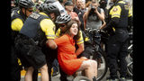 """Police officers detain a protester against right-wing demonstrators following an """"End Domestic Terrorism"""" rally in Portland, Ore., on Saturday, Aug. 17, 2019. Although the main protest remained largely peaceful, some skirmishes erupted in the following hours and police detained multiple protesters. (AP Photo/Noah Berger)"""