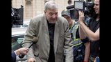 """In this Feb. 26, 2019, photo, Cardinal George Pell leaves the County Court in Melbourne, Australia. Pell's lawyers argued in his appeal that there were more than a dozen """"solid obstacles"""" that should have prevented a jury from finding him guilty beyond a reasonable doubt of molesting two choirboys. The appeal court will give their verdict on Aug. 21. (AP Photo/Andy Brownbill)"""