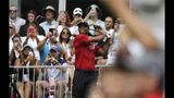 Tiger Woods watches his tee shot on the 14th hole during the final round of the BMW Championship golf tournament at Medinah Country Club, Sunday, Aug. 18, 2019, in Medinah, Ill. (AP Photo/Nam Y. Huh)
