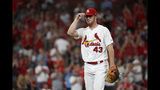 St. Louis Cardinals starting pitcher Dakota Hudson walks to the dugout after being removed during the seventh inning of a baseball game against the Milwaukee Brewers, Monday, Aug. 19, 2019, in St. Louis. (AP Photo/Jeff Roberson)