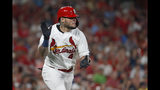 St. Louis Cardinals' Yadier Molina applauds as he runs up the line after hitting a single during the fifth inning of a baseball game against the Milwaukee Brewers, Monday, Aug. 19, 2019, in St. Louis. (AP Photo/Jeff Roberson)