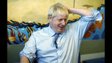 Britain's Prime Minister Boris Johnson speaks with staff during a visit to the Royal Cornwall Hospital in Truro, south-west England, Monday Aug. 19, 2019. Johnson is under increasing pressure Monday to recall Parliament after leaked government documents warned of widespread problems if the U.K. leaves the European Union without a Brexit withdrawal agreement. (Peter Nicholls/Pool via AP)