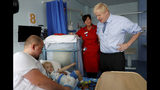 Britain's Prime Minister Boris Johnson meets patients and families during a visit to the Royal Cornwall Hospital in Truro, south-west England, Monday Aug. 19, 2019. Johnson is under increasing pressure Monday to recall Parliament after leaked government documents warned of widespread problems if the U.K. leaves the European Union without a Brexit withdrawal agreement. (Peter Nicholls/Pool via AP)