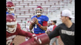 RETRANSMISSION TO CORRECT CITY TO NORMAN - Oklahoma quarterback Jalen Hurts looks for an open receiver during NCAA college football practice at Gaylord Family Oklahoma Memorial Stadium, Monday, Aug. 12, 2019 in Norman, Okla. (Alonzo Adams/Tulsa World via AP)