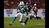 Tampa Bay Buccaneers defensive back Sean Murphy-Bunting (26) grabs Miami Dolphins wide receiver Kenny Stills (10) after a reception during the first half of an NFL preseason football game Friday, Aug. 16, 2019, in Tampa, Fla. (AP Photo/Mark LoMoglio)