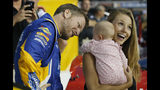 FILE - In this Sept. 21, 2018, file photo, Dale Earnhardt Jr. looks at his daughter, Isla, and his wife Amy on pit row prior to an Xfinity Series NASCAR auto race at Richmond Raceway in Richmond, Va. Earnhardt Jr. will take the weekend off from broadcasting to be with his wife and daughter after the three were in a plane crash landing Thursday, Aug. 15, 2019, near Bristol Motor Speedway. (AP Photo/Steve Helber, File)