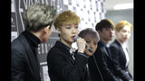 FILE - In this March 8, 2015, file photo, South Korean K-pop group EXO member Lay, second from left, speaks during a press conference in Seoul, South Korea. At least eight K-pop stars from China and even one from Taiwan and one from Hong Kong are publicly stating their support for the one-China policy, eliciting a mixture of disappointment and understanding from fans. It's the latest example of how celebrities and companies feel the pressure to toe the line politically in the important Chinese market. (AP Photo/Ahn Young-joon, File)