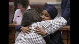 U.S. Rep. Ilhan Omar gave hugs and handshakes Thursday in the Minneapolis City Council Chambers before Minneapolis Mayor Jacob Frey's budget address Thursday, Aug. 15, 2019, in Minneapolis. (Brian Peterson/Star Tribune via AP)
