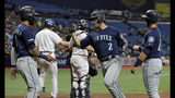 Seattle Mariners' Tom Murphy (2) celebrates with J.P. Crawford (3) and Austin Nola (23) after Murphy hit a three-run home run off Tampa Bay Rays starting pitcher Brendan McKay during the first inning of a baseball game, Monday, Aug. 19, 2019, in St. Petersburg, Fla. (AP Photo/Chris O'Meara)