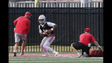 FILE - In this Aug. 2, 2019, file photo, Ohio State quarterback Justin Fields runs a drill during NCAA college football practice in Columbus, Ohio. Georgia transfer Justin Fields' performance will be key to the Buckeyes' hopes of returning to the College Football Playoff for the first time since the 2016-17 season.(AP Photo/Jay LaPrete, File)