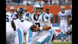 Carolina Panthers quarterback Kyle Allen looks to hand off the ball during the first half of the team's NFL preseason football game against the Chicago Bears on Thursday, Aug. 8, 2019, in Chicago. (AP Photo/Mark Black )