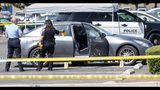 Police investigate a car where a retired Cal State Fullerton administrator was stabbed to death Monday, August 19, 2019 in Fullerton, Calif. The stabbing happened in Parking Lot S at College Place and Langsdorf Drive in Fullerton. (Paul Bersebach/The Orange County Register via AP)