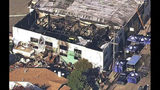FILE - This Dec. 3, 2016, file image from video provided by KGO-TV shows the Ghost Ship Warehouse after a fire swept through the building in Oakland, Calif. A judge has ordered deliberations to start over in the trial of two men accused of turning a San Francisco Bay Area warehouse into a cluttered maze where 36 partygoers died during a fire. Alameda County Superior Court Judge Trina Thompson excused three jurors Monday, Aug. 19, 2019, in the trial of Derick Almena and Max Harris on the 10th day of deliberations. It comes after a four-month trial on involuntary manslaughter charges. (KGO-TV via AP, File)