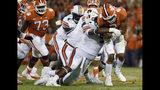 FILE - In this Sept. 9, 2017, file photo, Clemson quarterback Kelly Bryant (2) is tackled by Auburn defensive lineman Derrick Brown (5) during the second half of an NCAA college football game, in Clemson, S.C. Brown bypassed a chance to go to the NFL after last season and is an AP preseason All-American as selected by poll voters. (AP Photo/Rainier Ehrhardt, File)