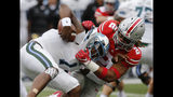 FILE - In this Sept. 22, 2018, file photo, Ohio State defensive end Chase Young, right, sacks Tulane quarterback Jonathan Banks during the first half of an NCAA college football game in Columbus, Ohio. Young made 14.5 tackles for loss in 2018 to be selected an AP preseason All-American by poll voters. (AP Photo/Jay LaPrete, File)