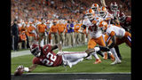 FILE - In this Jan. 7, 2019, file photo, Alabama's Najee Harris reaches for the end zone during the first half the NCAA college football playoff championship game against Clemson, in Santa Clara, Calif. Najee Harris has been a presence in Alabama's backfield pretty much since he arrived as one of the nation's top recruits. Now, he's finally the lead runner. (AP Photo/David J. Phillip, File)