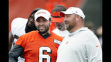 FILE - In this June 4, 2019, file photo, Cleveland Browns quarterback Baker Mayfield (6) talks with head coach Freddie Kitchens at the team's NFL football training facility in Berea, Ohio. Browns coach Freddie Kitchens says he doesn't care if controversial comments by brash quarterback Baker Mayfield put a target on his team. (AP Photo/Ron Schwane, File)