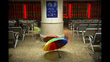 Umbrellas sit in a stock brokerage house in Beijing, Tuesday, Aug. 20, 2019. Asian shares were mostly higher Tuesday after Wall Street rallied on the U.S. decision to give Chinese telecom giant Huawei another 90 days to buy equipment from American suppliers. (AP Photo/Mark Schiefelbein)