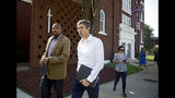 Democratic presidential candidate Beto O'Rourke, right, and Rev. Robert L. Turner Sr. pass the the Vernon AME Church while on a tour of the Greenwood District in Tulsa, Okla., Monday, Aug. 19, 2019. (Mike Simons/Tulsa World via AP)