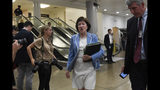 FILE - In this July 10, 2019, file photo, Sen. Susan Collins, R-Maine, walks past reporters on Capitol Hill in Washington, as she heads to a briefing on election security. National money is already flowing into Maine's 2020 Senate race, offering the latest indicator that incumbent Collins faces a stiff reelection fight. (AP Photo/Susan Walsh, File)