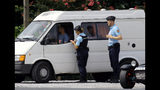 French police officers check vehicles, in Saint Pee sur Nivelle, southwestern France, Sunday, Aug. 18, 2019. ahead of the G7 summit which will take place in Biarritz on Aug. 24-26, 2019. (AP Photo/Bob Edme)