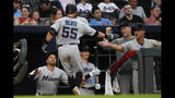 Miami Marlins' Jon Berti is congratulated by Miami Marlins manager Don Mattingly, right, as he enters the dugout after a home run against the Atlanta Braves during the third inning of a baseball game Tuesday, Aug. 20, 2019, in Atlanta. (AP Photo/John Amis)